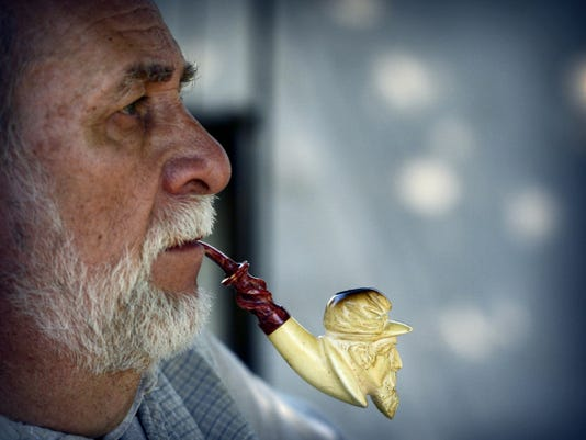 Al Kaspar of Freeland, Md., enjoys his pipe after a Civil War reenactment battle on Saturday at Union Canal Tunnel Park.