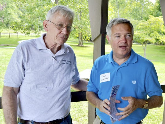 Adams County commissioner candidate Harry Stokes, left, talks with former commissioner Tom Weaver.