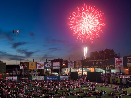 Fireworks explode over the outfield wall during the Independence Day celebration at then Sovereign Bank Stadium in 2013. July4York kicks off at 5:30 p.m. this year at Brooks Robinson Plaza.