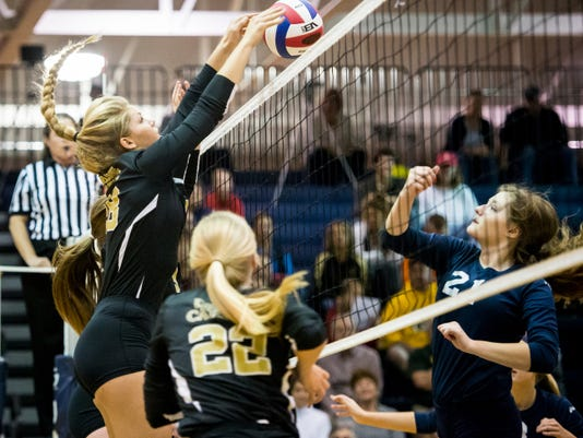 Delone Catholic's Amber Johnson (28) rises for a block of a shot by West York's Tailyn Kite (21) in the District 3 Class AA volleyball quarterfinal at Dallastown Area High School on Tuesday.