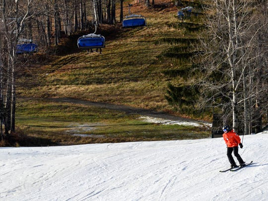 A skier plies a slope at Mount Snow Resort in West Dover on Friday, Nov. 27, 2015.