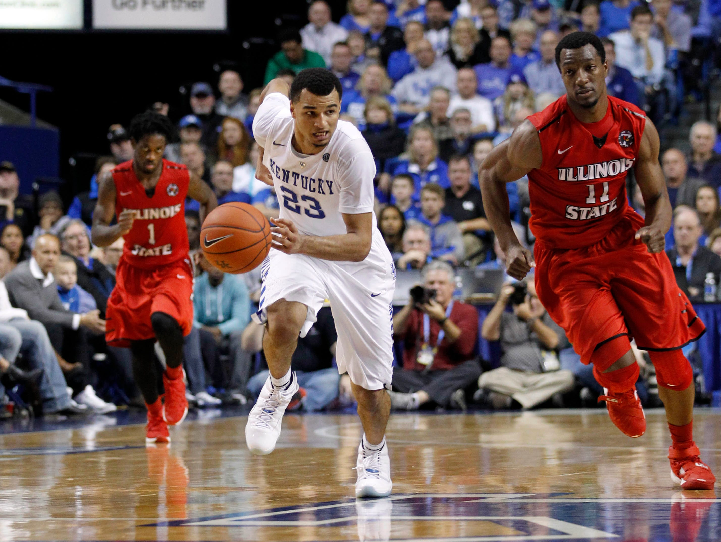 Nov 30, 2015; Lexington, KY, USA; Kentucky Wildcats guard Jamal Murray (23) dribbles the ball against Illinois State Redbirds forward MiKyle McIntosh (11) in the second half at Rupp Arena. Mandatory Credit: Mark Zerof-USA TODAY Sports