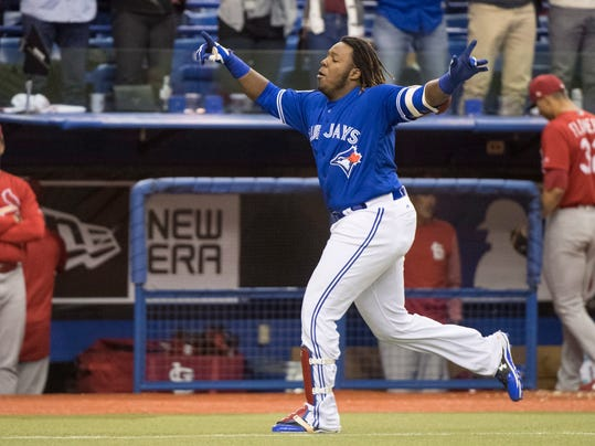 Toronto Blue Jays' Vladimir Guerrero Jr. celebrates his home run against the St. Louis Cardinals during the ninth inning of a baseball exhibition game Tuesday, March 27, 2018, in Montreal. (Paul Chiasson/The Canadian Press via AP)
