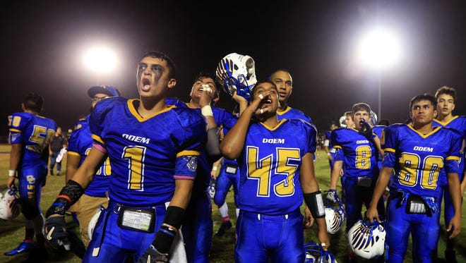 Odem players Joshua Ceballos (left) and Justin Rodriguez celebrate their team's win against Hebbronville at Owl Stadium on Friday, Oct. 28, 2016.