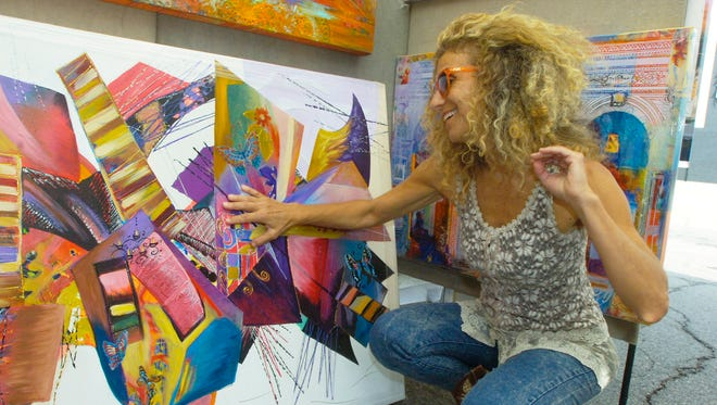 Artist Smadar Livne displayed mixed media paintings in her booth at a past Birmingham Art Fair. The 2020 art fair has been canceled due to COVID-19.