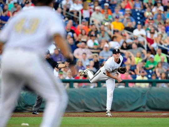 Vanderbilt third baseman Will Toffey throws the ball to first during the second inning against Virginia in the last game of the College World Series on June 24, 2015.