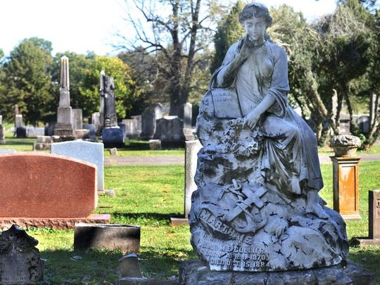 One of two statues in the likeness of teenage cousins that died 2 years apart are in the Evergreen Cemetery on Tuesday, Oct. 20, 2015.