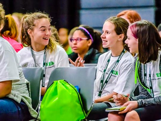 About 150 mid-Michigan girls took part in the EmpowHER