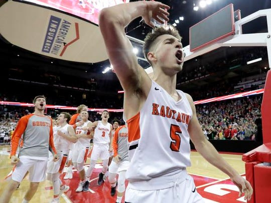 Kaukauna's Jordan McCabe celebrates against Milwaukee Washington during the WIAA Division 2 state championship boys basketball game March 17, 2018, at the Kohl Center in Madison.
