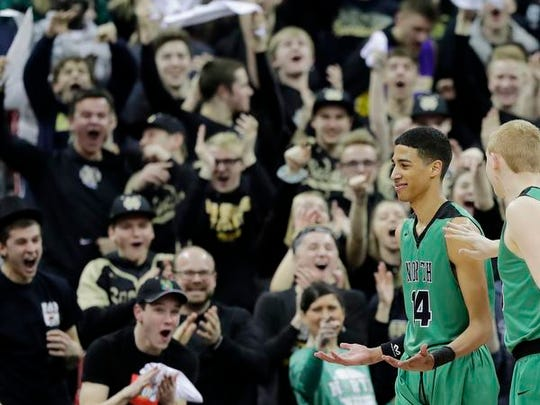 Oshkosh North's Tyrese Haliburton (14) reacts after
