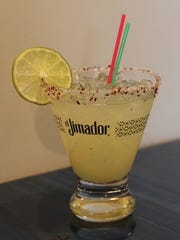 A house margarita comes with lime and raw agave at