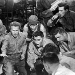 """Tom Hanks stars in """"Saving Private Ryan."""" The film's harrowing opening scene depicts the assault on Omaha Beach."""