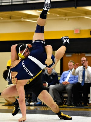 Red Lion's Dylan Gurreri slams Dallastown's Hayden Jones in a match last season. Gurreri is the top seed from Section 4 entering the District 3 3-A tournament. (Dawn J. Sagert - The York Dispatch)
