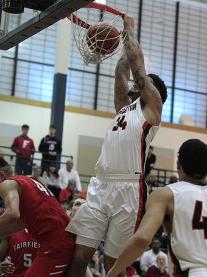 Wilmington's Jarron Cumberland slams home two of his 39 points.