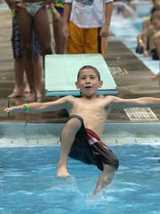 Chase Archiquette, 7, of Green Bay flips into Colburn Pool during Kids' Day.