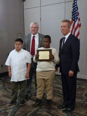 Bright Beginnings Learning Center students Galuco DaSilva (left), and Jason Raymond accepted the Coding and Robotics Club Innovations in Special Education Award from NJSBA President Donald Webster Jr. (left) and ASAH President Dr. Steven Morse.