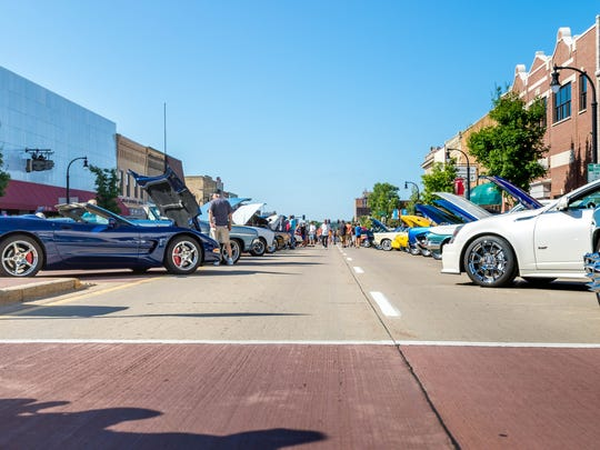 Visitors check out cars during the Hub City Car Show on Saturday, July 29, 2017, in Marshfield.