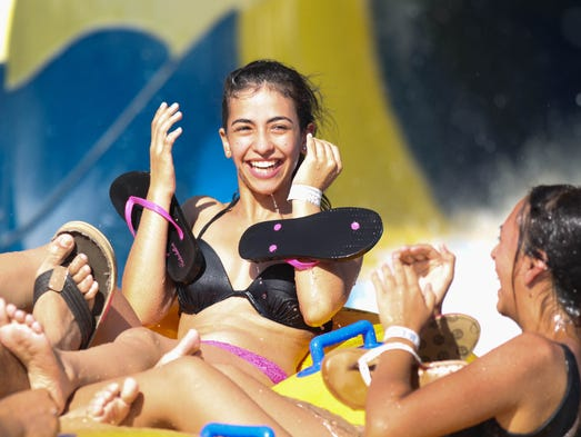 Golfland Sunsplash in Mesa:Diana Arambula, 17, of Phoenix smiles after a ride on the Stormrider in June 2013.