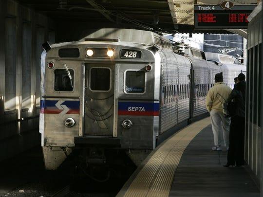 A SEPTA regional train, the R7, rolls into 30th Street
