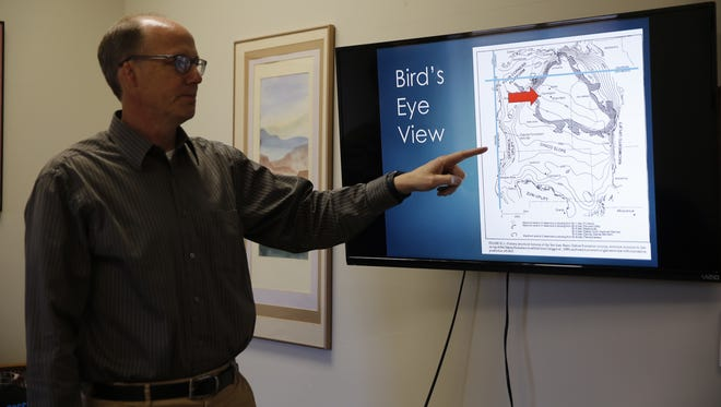 John Byrom talks about his presentation on the San Juan Basin at his PESCO office in Farmington earlier this month.