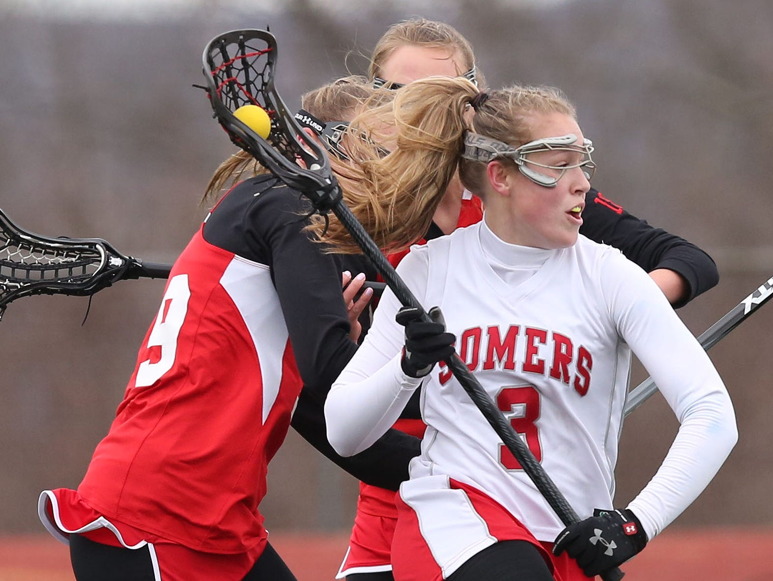 Somers' Gabby Rosenzweig (3) drives to the goal against Fox Lane during a girls lacrosse game at Somers High School April 8, 2016. Somers won the game 15-12.