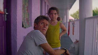 "In ""The Florida Project,"" Bobby (Willem Dafoe) keeps an eye on Moonee (Brooklynn Prince)."
