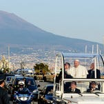 Pope Francis arrives in Naples, Italy, on Saturday for a meeting with young people. At left is the volcano Mount Vesuvio.