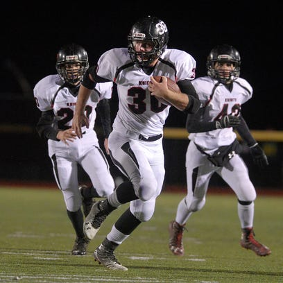 Le Roy's Nick Egeling, center, returns an interception for a touchdown during a regular season game played at Caledonia-Mumford High School on Friday, Oct. 9, 2015.