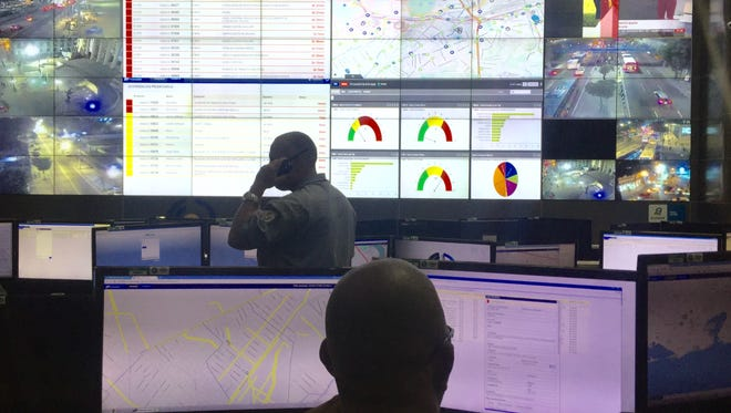 Law enforcement officials monitor video from around Rio de Janeiro at the city's Integrated Center of Command and Control. The center will serve as law enforcement's nerve center during the Olympic Games in August.