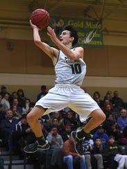 Bishop Manogue's Kolton Frugoli (10) drives to the