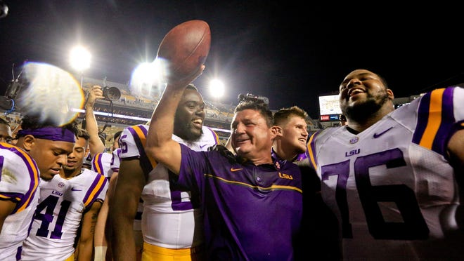 LSU Tigers interim head coach Ed Orgeron celebrates following a win in his first game against the Missouri Tigers at Tiger Stadium. LSU defeated Missouri 42-7.