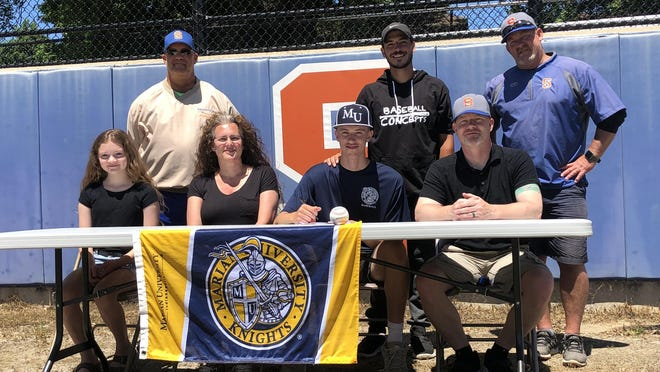 Wyatt Larsen signs with Marian University. Front row, from left, sister Sage Larsen, mother Sarah Larsen, Wyatt Larsen and father Mike Larsen. Back row, Saugatuck Athletic Director Bill Dunn, Baseball Concepts coach Devin Schaefers and  Saugatuck coach Tim Antel.