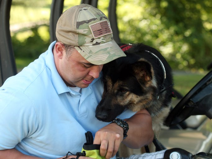 Retired Maj. William Lyles, a two-tour veteran of Iraq, and one of Afghanistan has flown from an Army hospital in San Antonio, Texas to New Jersey to get Spartan during a leash ceremony at Picatinny Arsenal. Spartan is trained especially for him by K9 Soldiers, Inc. July 24, 2014, Rockaway, NJ. Photo by Bob Karp