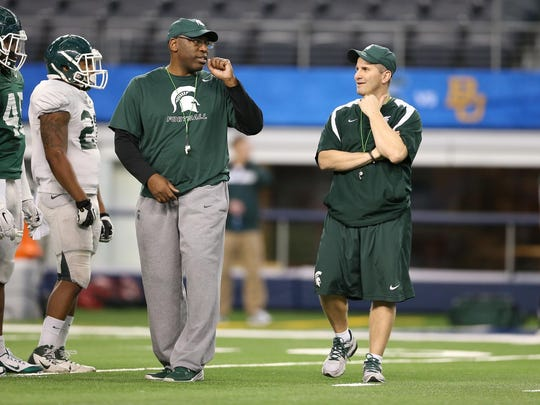 Harlon Barnett, left, and Mike Tressel were Michigan State's co-defensive coordinators under Mark Dantonio.