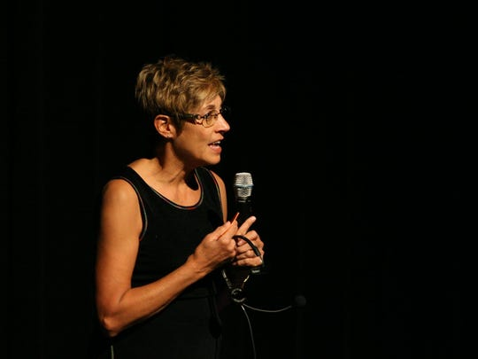 Marlene Turbin-Weldon speaks to an audience at the 2012 spring recital at the Performing Arts Center of Wisconsin Rapids.