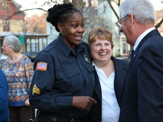 Angie Fowler, Wesley College's safety and security shift supervisor, and Christine Gibson, vice president for finance, talk with Marvin Gibson at the inauguration last week.