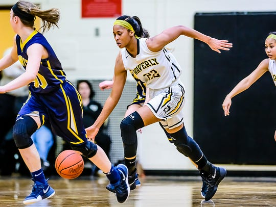 Alisia Smith of Waverly races to the DeWitt basket