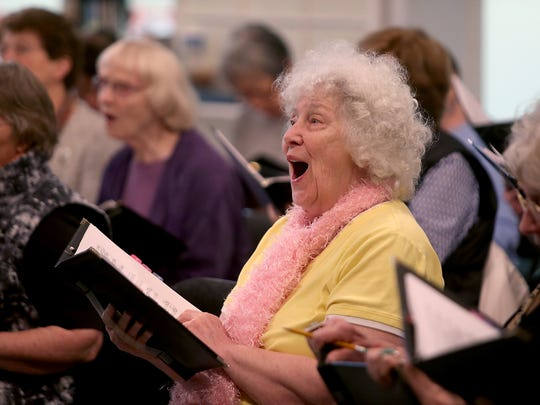 "Eliz Johnson, 85, and fellow Evergreen Singers practice their rendition of ""Lullaby of Broadway"" Tuesday at the Waterfront Park Community Center. The chorale group performs at the center and throughout the community."