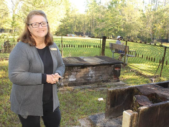 Old Cahawba Director Linda Derry visits a final resting place at a family plot. Alvin Benn/Special to the Advertiser.