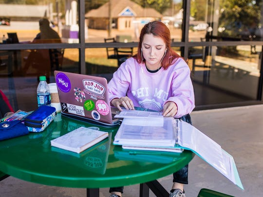 Emily Arnaud, a sophomore nursing major at Northwestern State University, studies outside of Watson Memorial Library.