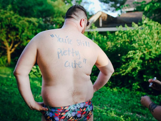 One man wore a floral print swimsuit to the photo shoot