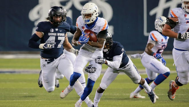 Boise State wide receiver Cedrick Wilson runs with the ball after a catch last week against Utah State.