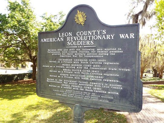 A state historic marker in Bloxham Park, between Calhoun