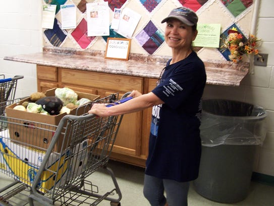 Volunteer Ellie Tomkow helps distribute Forgotten Harvest