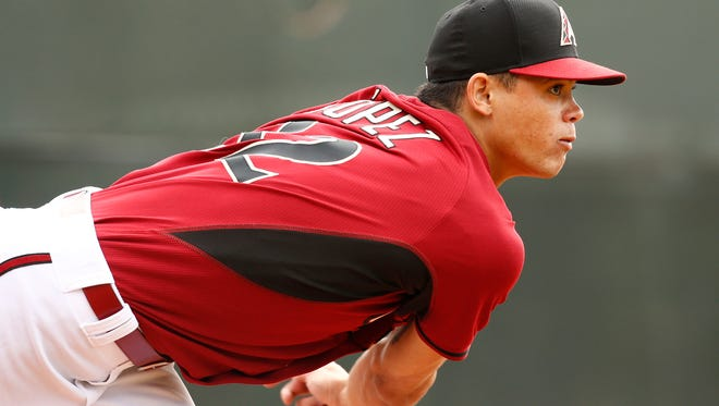 Arizona Diamondbacks pitcher Yoan Lopez throws during spring training on Sunday, Feb. 22, 2015.