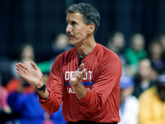 In this Oct. 5, 2013, file photo, Detroit Pistons strength and conditioning coach Arnie Kander claps during the Pistons' basketball camp at the Palace.