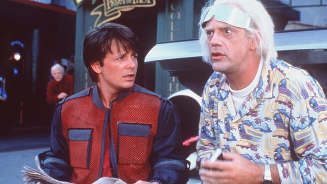 """Marty McFly (Michael J. Fox) and Doc Brown (Christopher Lloyd) in """"Back to the Future Part II."""""""