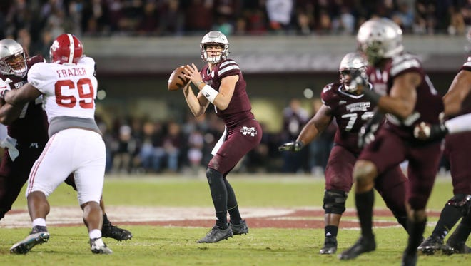 Mississippi State's Nick Fitzgerald (7) eyes a receiver during a third-quarter scoring drive Saturday in Starkville.