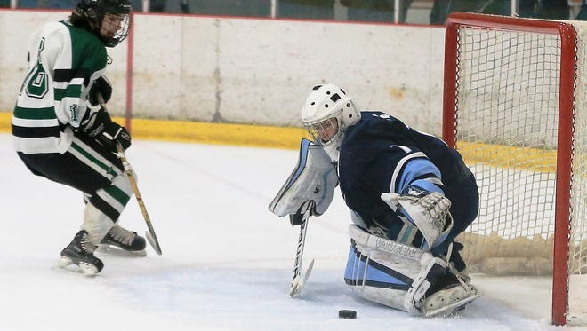 Making a stop last season is Livonia Stevenson goalie Will Tragge (right).