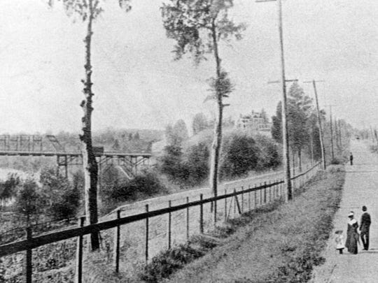 This was the view of Kingston Pike in 1907. An accompanying article states the location of this image somewhere west of 2728 Kingston Pike. The large house between the tree and utility pole was owned by a family named Cox and was built in the 1830s.